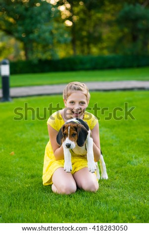 Friend of a dog. Little caucasian girl embraces her faithful pet and looks right in the camera. Happy eyes. Connection between people and animals. - stock photo