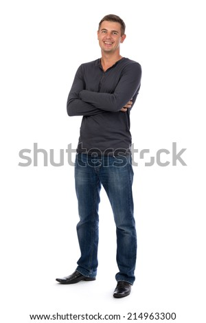 Friendly adult male with his arms folded smiling at the camera - isolated on white - stock photo