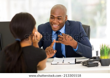 friendly african american businessman meeting with client - stock photo