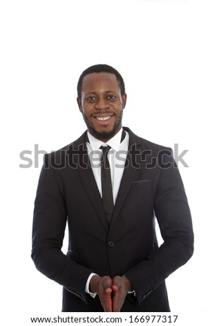 Friendly african businessman in a stylish suit and tie standing facing the camera with a smile, isolated on white