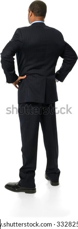 Friendly African man with short black hair in business formal outfit with hands on hips - Isolated