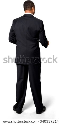 Friendly African man with short black hair in evening outfit giving thumbs up - Isolated