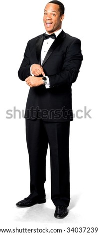 Friendly African man with short black hair in evening outfit holding wristwatch - Isolated