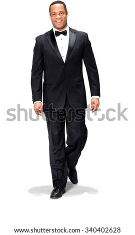Friendly African man with short black hair in evening outfit walking - Isolated