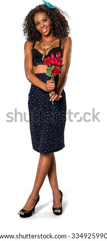 Friendly African woman with medium dark brown hair in casual outfit holding flowers - Isolated
