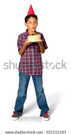 Friendly African young boy with short black hair in casual outfit holding cake - Isolated