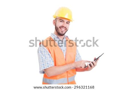 Friendly and modern construction worker or builder using tablet - stock photo
