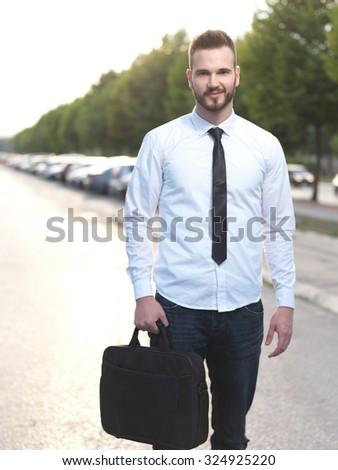 Friendly and smiling handsome businessman looking confidently