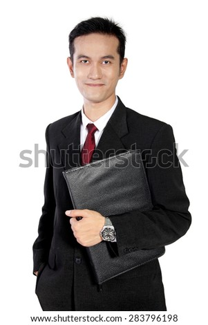 Friendly Asian businessman posing casually with a black documents holder, isolated on white background