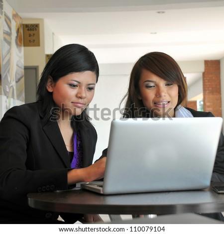Friendly Asian businesswoman - stock photo