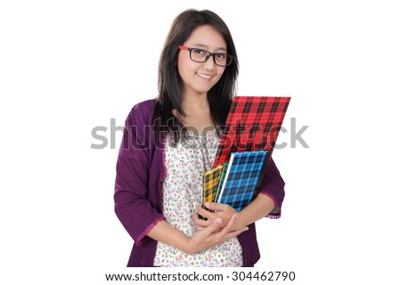 Friendly Asian librarian woman pose with some books and smile to camera, isolated on white background - stock photo