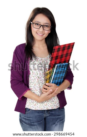 Friendly Asian teacher holding some books and smile to camera, isolated on white background - stock photo