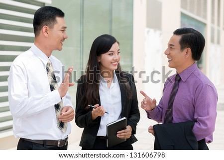 Friendly business discussion of co-workers - stock photo