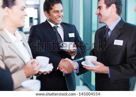 friendly business people interacting during conference break - stock photo