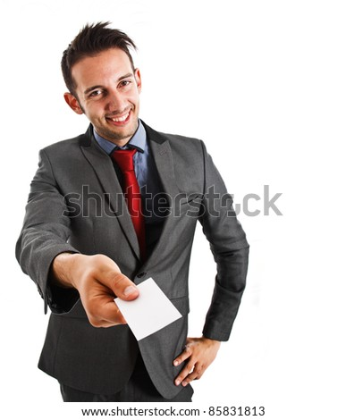 Friendly businessman giving a business card - stock photo