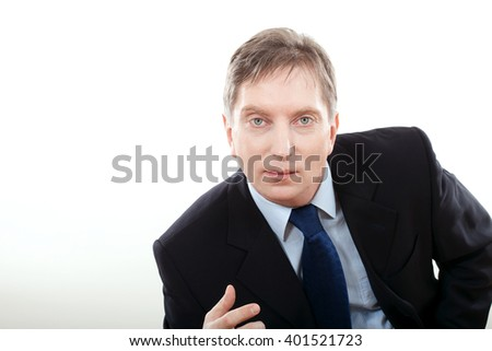 Friendly businessman in tie against neutral background with lots of copy space close up