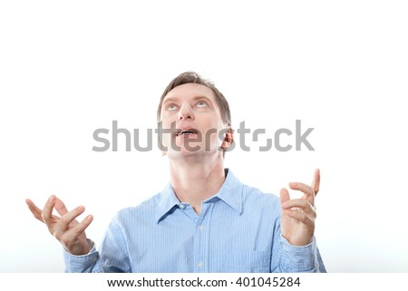 Friendly businessman looking up and his hands up, screaming about the success on white background