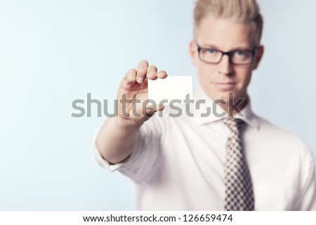 Friendly businessman presenting white empty business card with space for text, isolated. - stock photo