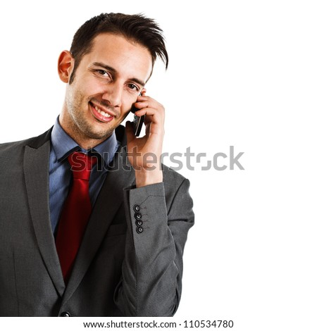 Friendly businessman using a smartphone. Isolated on white - stock photo