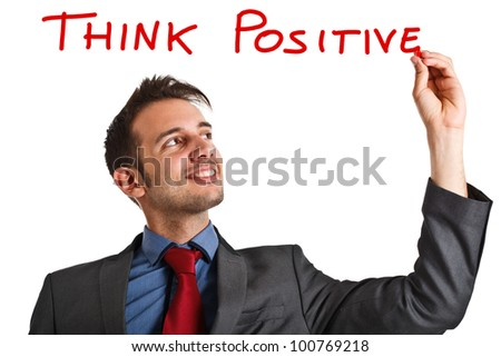 Friendly businessman writing a positive concept on the screen - stock photo