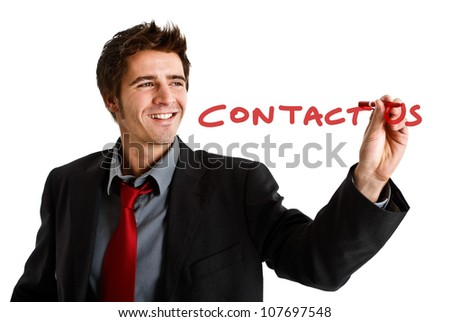 Friendly businessman writing Contact Us on the screen