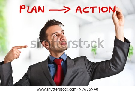 Friendly businessman writing his simple strategy on the screen