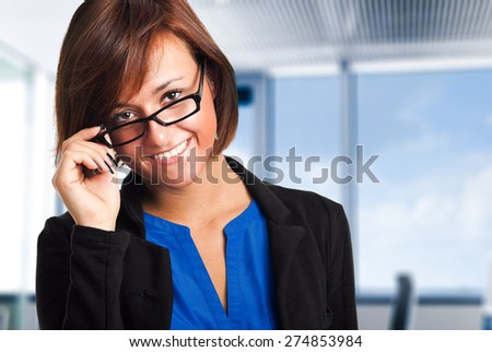Friendly businesswoman holding her glasses - stock photo
