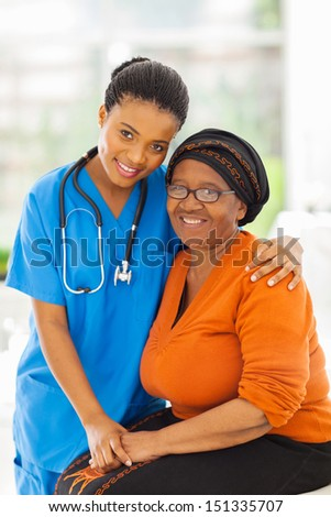 friendly caring young african nurse and senior patient