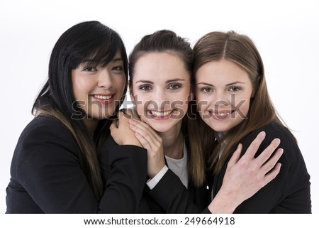 friendly Caucasian and Chinese business women. Isolated on white background. - stock photo