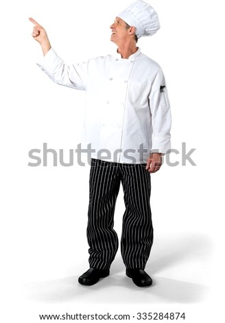Friendly Caucasian Chef with short white hair in uniform pointing using finger - Isolated