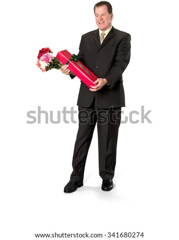 Friendly Caucasian elderly man with short medium brown hair in business formal outfit holding flowers - Isolated