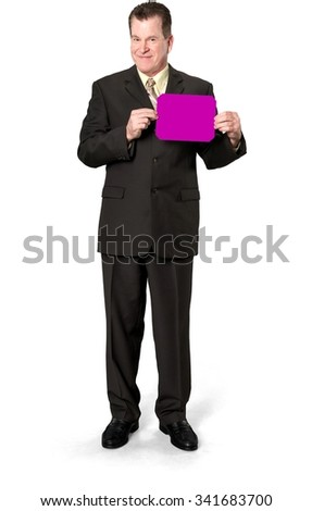 Friendly Caucasian elderly man with short medium brown hair in business formal outfit holding medium sign - Isolated