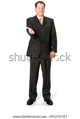 Friendly Caucasian elderly man with short medium brown hair in business formal outfit pointing using palm - Isolated