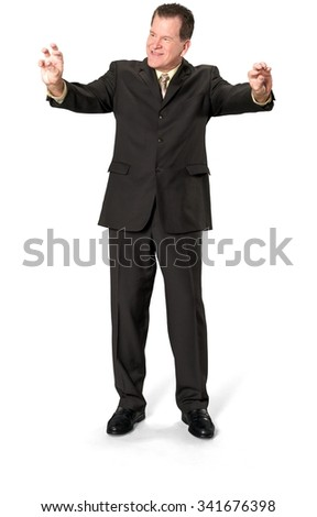 Friendly Caucasian elderly man with short medium brown hair in business formal outfit using invisible object - Isolated