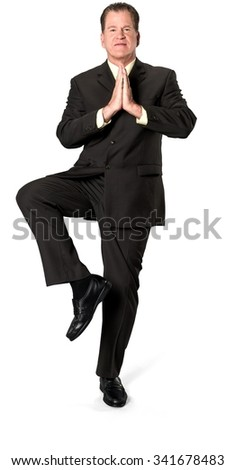 Friendly Caucasian elderly man with short medium brown hair in business formal outfit with meditation hands - Isolated