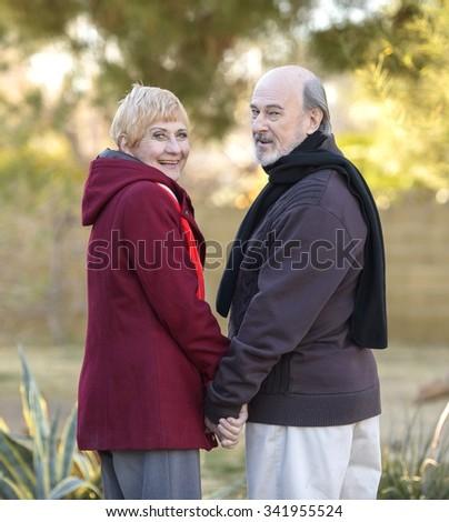 Friendly Caucasian elderly men with short red hair talking - stock photo