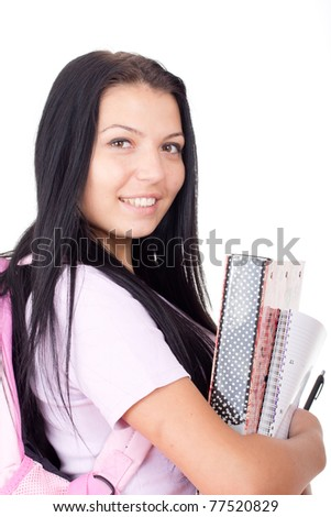 Friendly Caucasian High school girl student standing with backpack and holding books and  notebooks