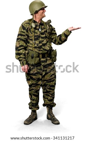 Friendly Caucasian man in uniform holding invisible object - Isolated