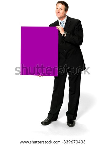 Friendly Caucasian man with short black hair in business formal outfit holding large sign - Isolated