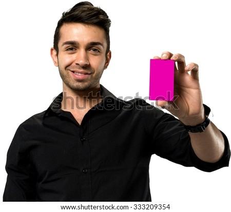 Friendly Caucasian man with short black hair in casual outfit holding business card - Isolated - stock photo