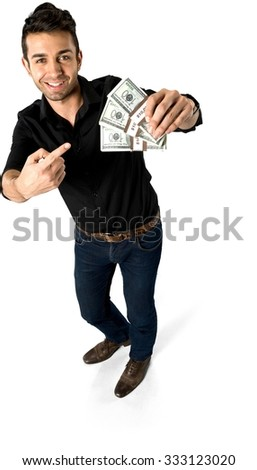 Friendly Caucasian man with short black hair in casual outfit holding money - Isolated