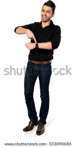 Friendly Caucasian man with short black hair in casual outfit pointing using finger - Isolated