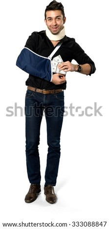 Friendly Caucasian man with short black hair in casual outfit using money - Isolated