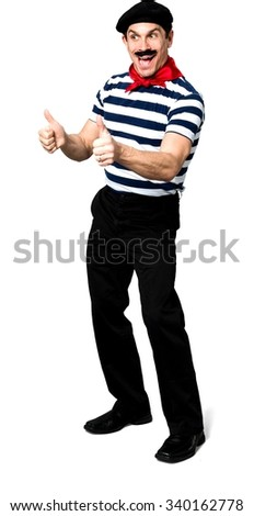 Friendly Caucasian man with short black hair in costume cheering - Isolated - stock photo