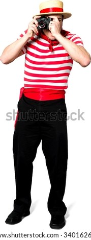 Friendly Caucasian man with short black hair in costume using camera - Isolated - stock photo