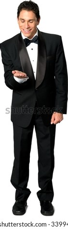 Friendly Caucasian man with short black hair in evening outfit holding invisible object - Isolated