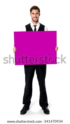 Friendly Caucasian man with short dark brown hair in business formal outfit holding large sign - Isolated - stock photo