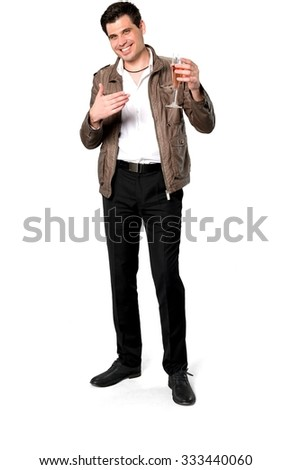 Friendly Caucasian man with short dark brown hair in casual outfit holding champagne glass - Isolated - stock photo