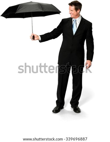 Friendly Caucasian man with short medium blond hair in business formal outfit holding umbrella - Isolated