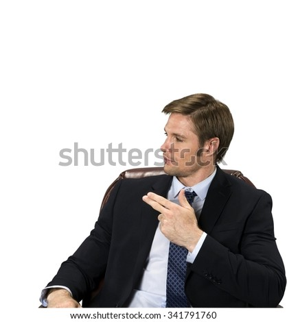 Friendly Caucasian man with short medium blond hair in business formal outfit makes finger gun - Isolated